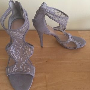 Silver suede high heeled shoes